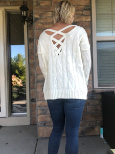 Cream cable sweater with crossy back