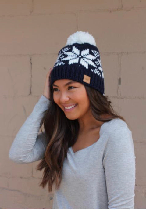 Navy fleece lined hat with pom
