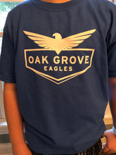Load image into Gallery viewer, Boy wearing blue oak grove eagles tee