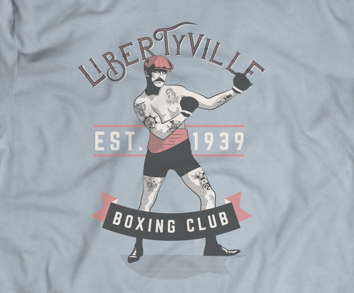 light blue tee with 1930s Libertyville Boxing Club design