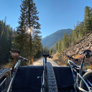 mountain bikes ride in the back of a pickup truck on the way to the trailhead in Crested Butte, Colorado.