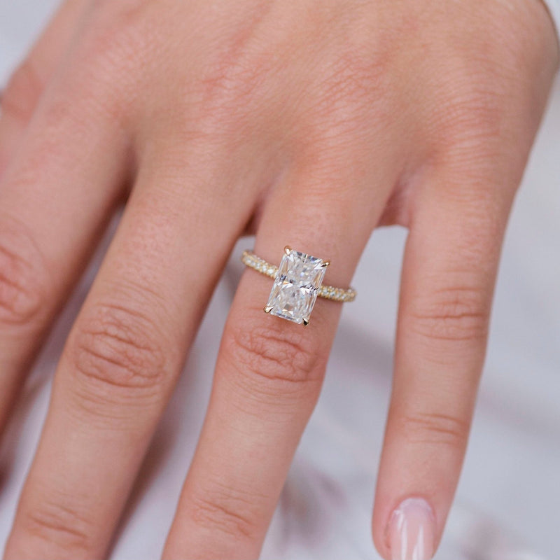 ROWAN 3 Carat (10x6.5mm) Elongated Crushed Ice Radiant Moissanite Engagement Ring with Invisible Halo in 18k Yellow Gold