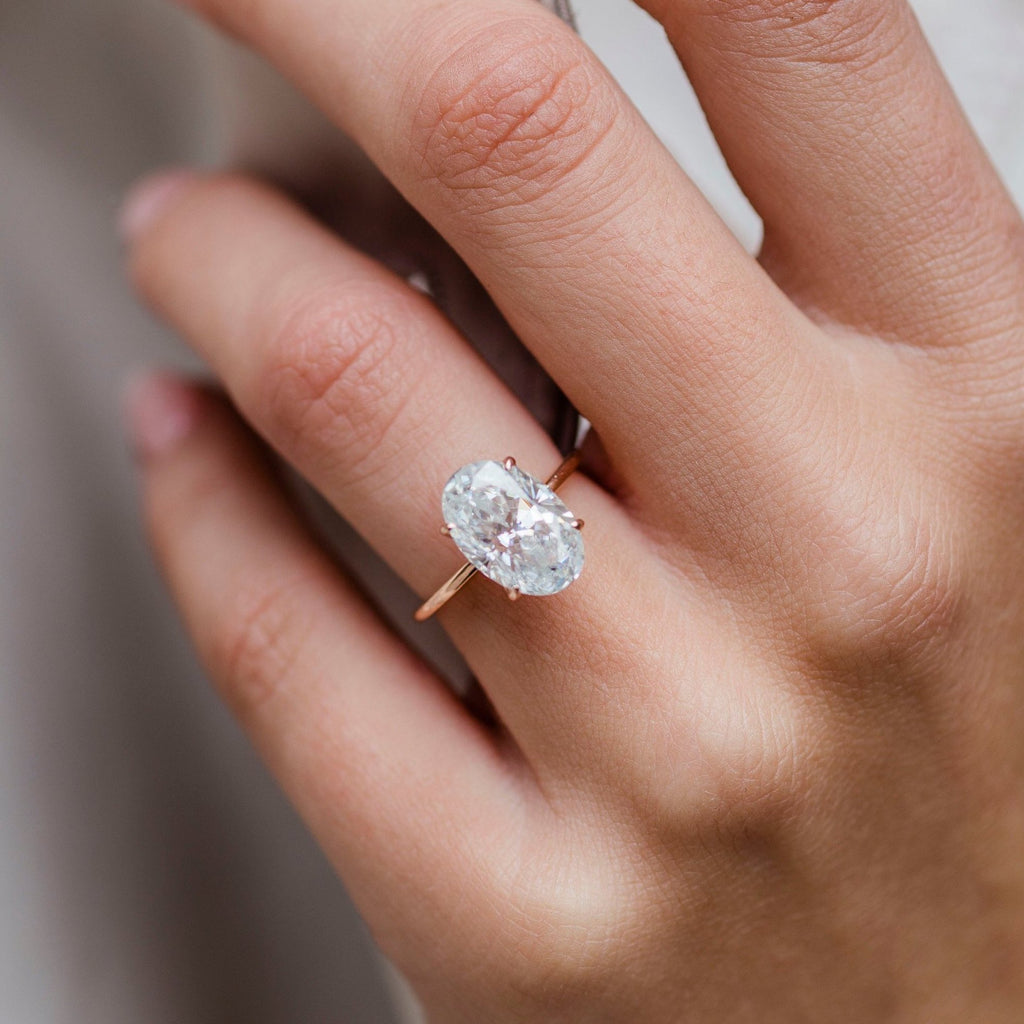 HARPER 4.7 Carat (12x8mm) Skinny Crushed Ice Oval Moissanite Solitaire Engagement Ring In 14k Rose Gold