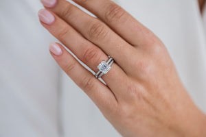 ROWAN 2.3 Carat (8x7mm) Elongated Asscher Moissanite Engagement Ring with Invisible Halo and Double Claw Prongs in 14K White Gold