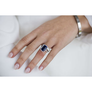 SOPHIA 6.5 Carat (13x8mm) Skinny Emerald Cut Lab Created Blue Sapphire Engagement Ring with Dainty Halo Setting in 14K White Gold