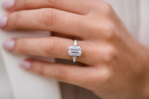 CAMILLA 3 Carat (9.5x7mm) Elongated Emerald Cut Moissanite Three Stone Engagement Ring with Tapered Baguettes Set In Platinum