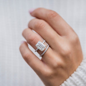 ROWAN 4.6 Carat (11x8mm) Elongated Emerald Cut Moissanite Engagement Ring with Invisible Halo and Micropave Setting in Platinum
