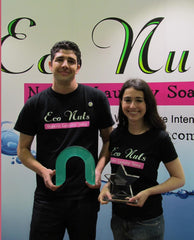 "Eco Nuts co-founders Scott Shields and Mona Weiss hold their awards for ""Best New Green Product"" and the ""Nexty"" award for being pioneers in the natural products industry. Credit Lois Weiss"