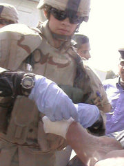 Sgt. Witzke aiding an injured Iraqi Policeman
