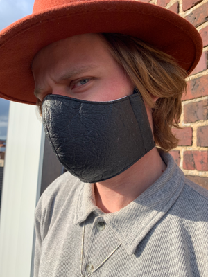 Piñatex vegan pineapple leather face mask in charcoal black on male