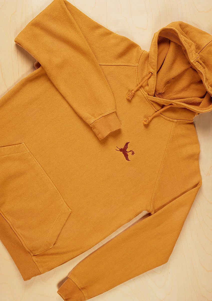 Sustainable hemp and bamboo hoodie in yellow with crane embroidery on chest