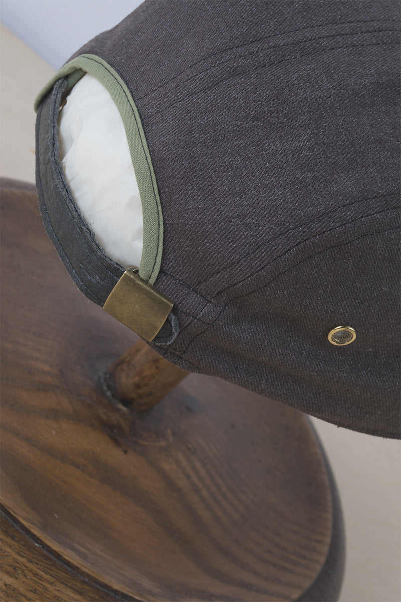 Ornament Hemp 5 panel cap with Piñatex vegan leather strap close up with metal buckle