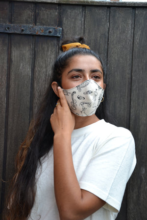 Sustainable Hemp face mask with black screen print on female