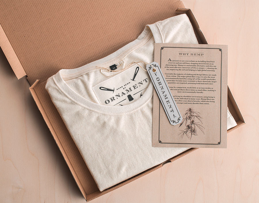 Ornament folded t-shirt with label and hemp info flyer in recyclable shipping box