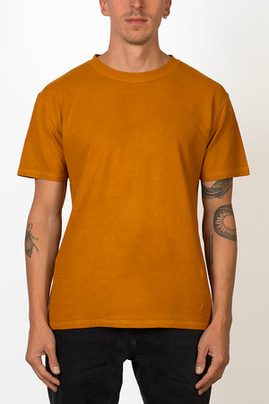 Sustainable Hemp and organic cotton T-shirt hand dyed in sunshine ocher yellow on male front