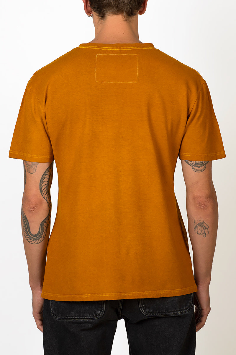Sustainable Hemp and organic cotton T-shirt hand dyed in sunshine ocher yellow on male back