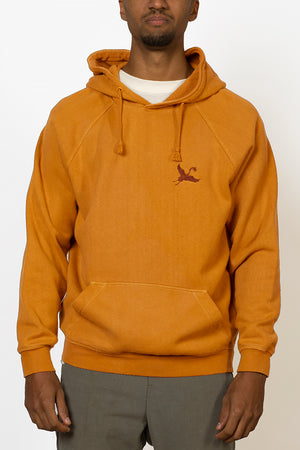 Sustainable hemp and bamboo hoodie in yellow with crane embroidery on chest front male