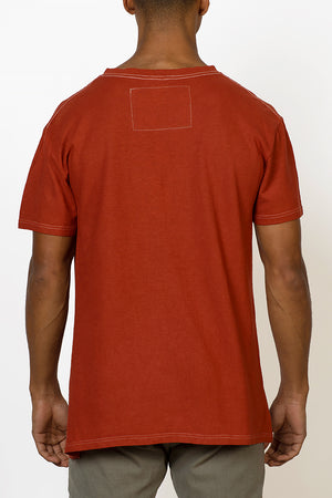 Sustainable Hemp T-shirt hand dyed in red on male back