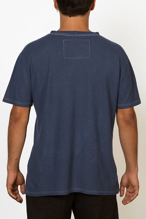 Sustainable Hemp T-shirt hand dyed in blue on male back