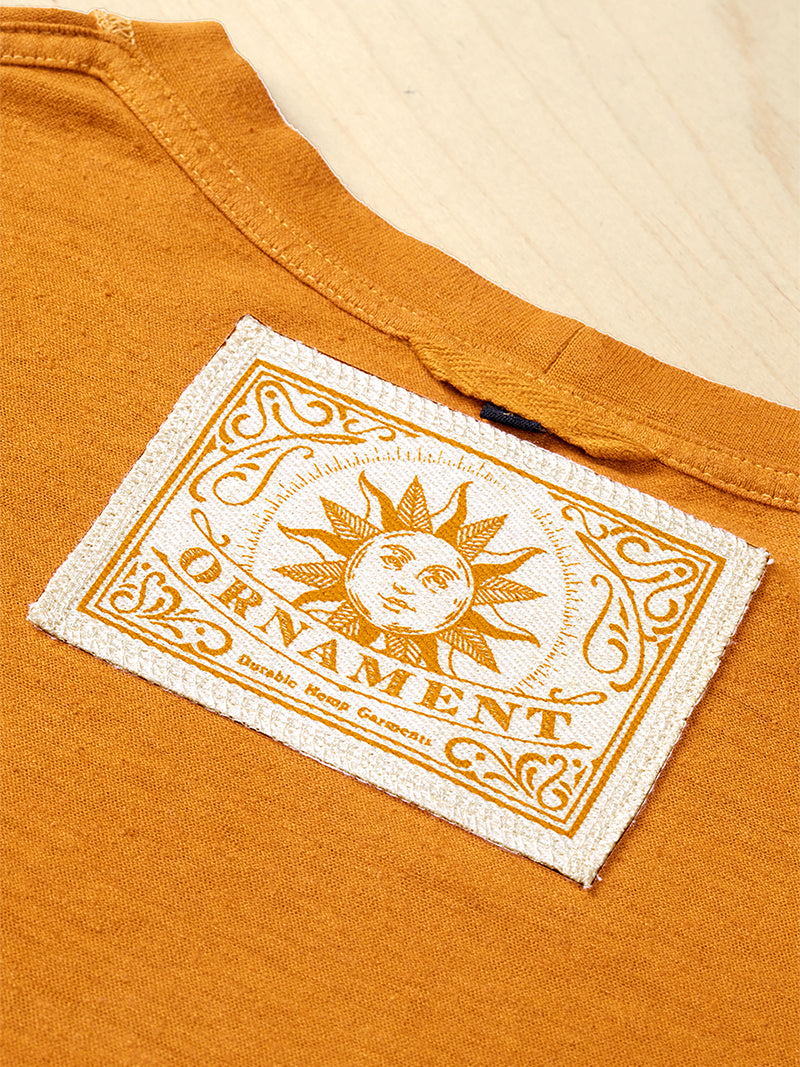 Sustainable Hemp and organic cotton T-shirt hand dyed in sunshine ocher yellow screen printed ornament neck label