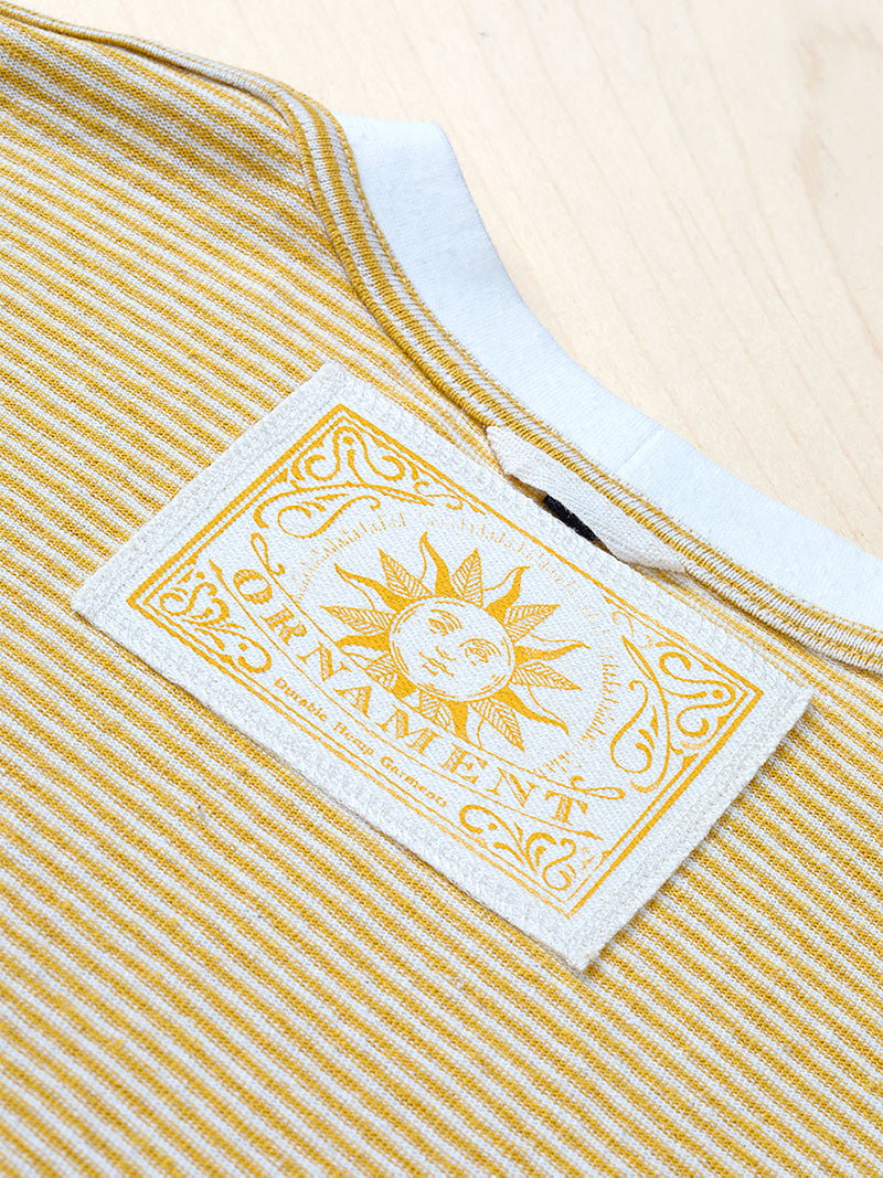Sustainable Hemp T-shirt with yellow stripes and yellow sun neck label