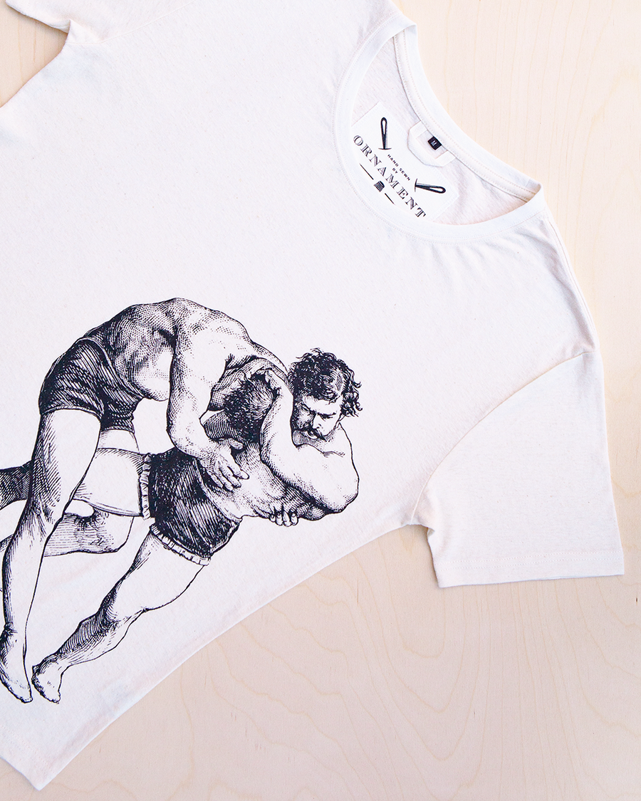 The struggle screen printed wrestling men print in black ink on hemp and organic cotton T-shirt in natural color_ Packshot
