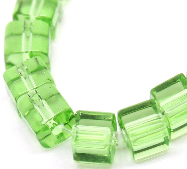 Glass cube beads, green, 5mm x 5mm.