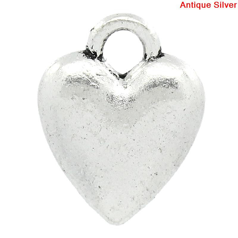 Antique silver heart charms.