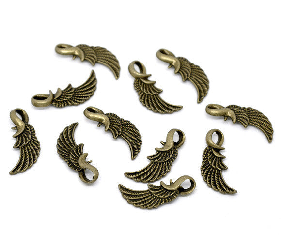 Antique bronze wing charms/pendants. 31mm x 14mm.