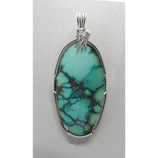 Spiderweb Turquoise set in Sterling Silver Wire