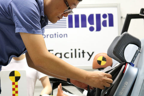 WAYB engineer adjusts a Pico travel car seat before safety testing