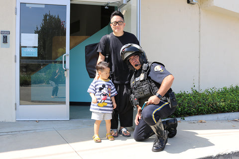 CPST Officer Marquez of the Pasadena Police Department arrives at WAYB, greeted by CEO Tio Jung and his son