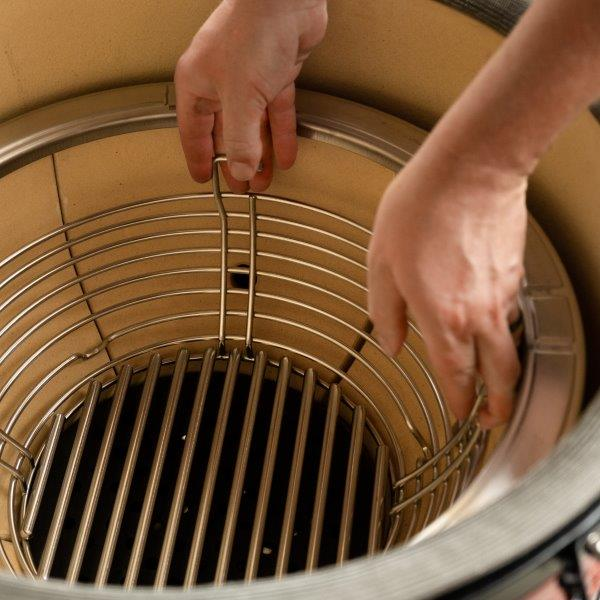 Inserting charcoal basket into the firebox