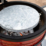 View image Soapstone ready to cook over charcoal