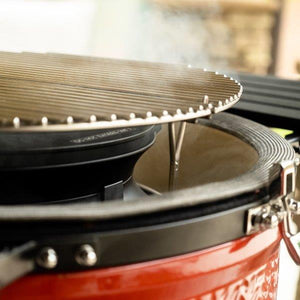SloRoller with stainless steel grate attachment in Kamdo Joe Grill