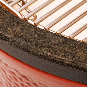 Felt gasket helps prevent heat loss when grill is closed