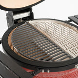 The Kamado Joe Half Moon Cast Iron Cooking Grate sharing grill space with a second half-moon surface