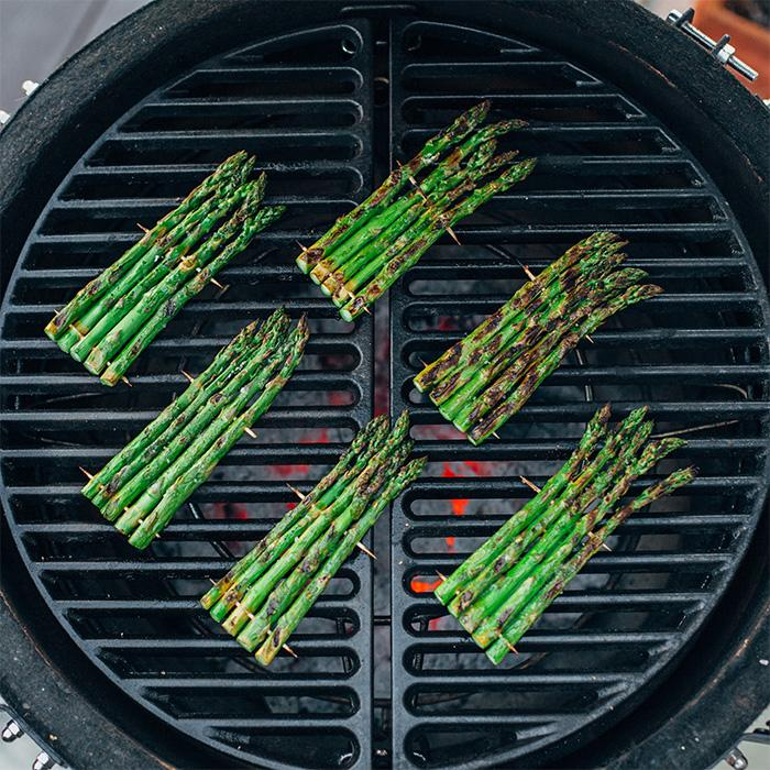 Asparagus being cooked on 2 Kamado Joe Half Moon Cast Iron Cooking Grates