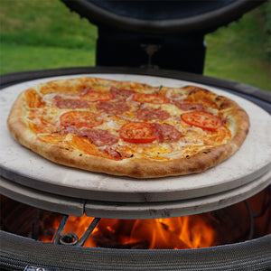 A pizza being cooked on a Kamado Joe® Ceramic Pizza Stone