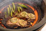 View image Salmon and okra being cooked to perfection on the Kamado Joe® Sear Plate