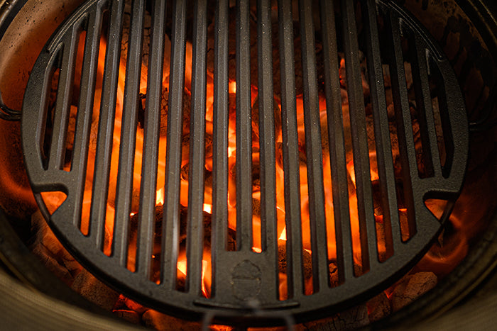 The Kamado Joe® Sear Plate heating up on a Kamado Joe grill