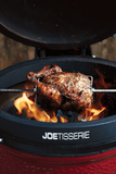 Chicken being cooked on the JoeTisserie