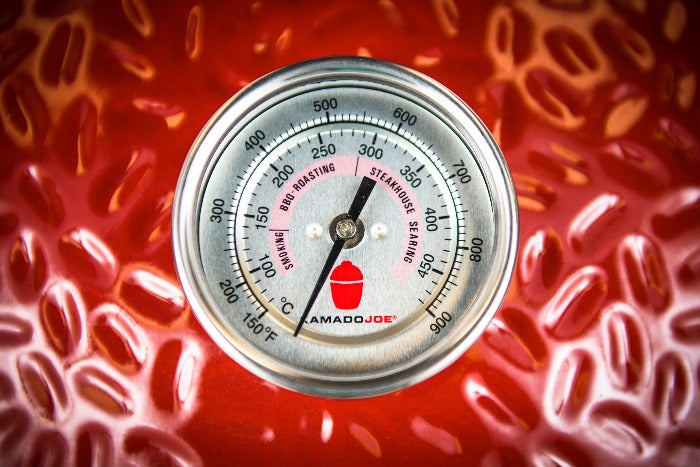 Thermometer inserted into grill dome
