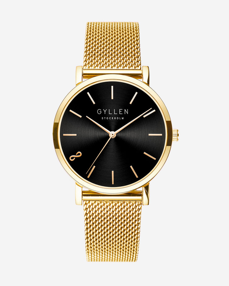 Gold Watch With Large Black Face On Gray Background