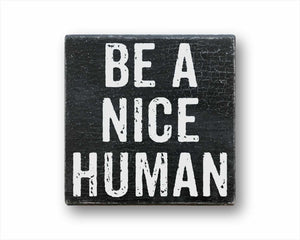 be a nice human box sign
