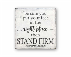 be sure to put your feet in the right place then stand firm box sign
