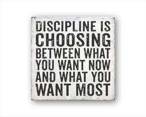 discipline is choosing between what you want now and what you want most box sign