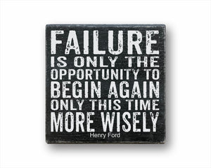 failure is the opportunity to begin again only this time more wisely box sign