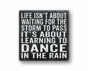 life isn't about waiting for the storm to pass it's about learning to dance in the rain box sign
