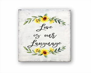 Love Is Our Language Sign